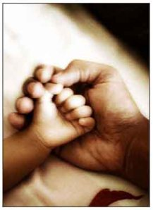A father holding childs hand