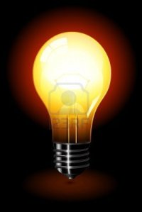 6568967-bright-light-bulb-standing-isolated-over-a-black-background